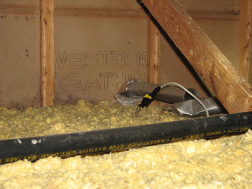 As you can see, attic inspections are very important! This amateur<br>wiring & unattached exhaust pipe could be dangerous!
