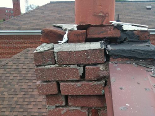 Damaged, deteriorated chimney requires<br>complete tear down and rebuild.